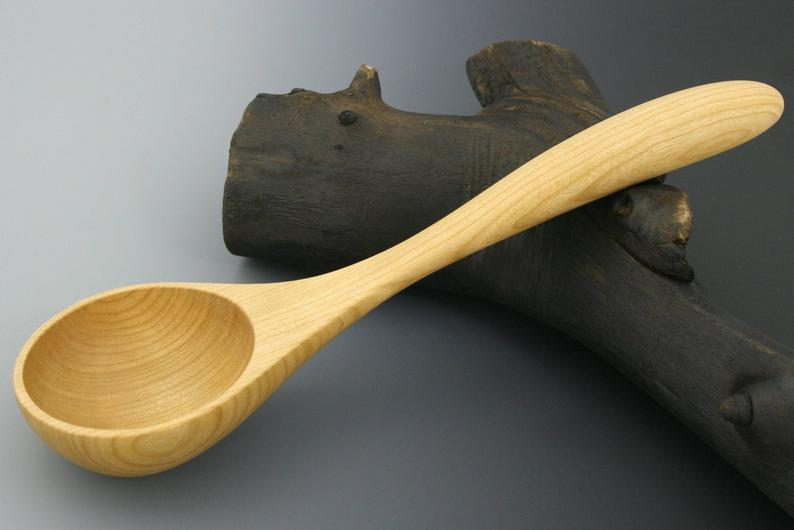 Small serving ladle in cherry wood.