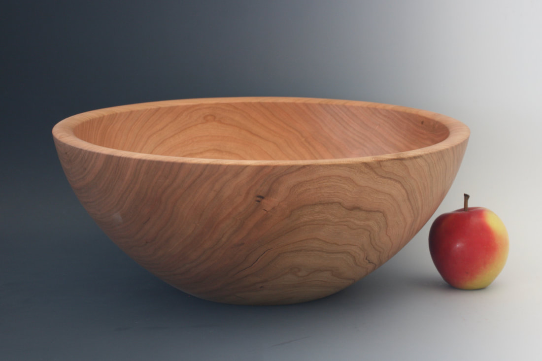 Large handmade cherry wood salad bowl.