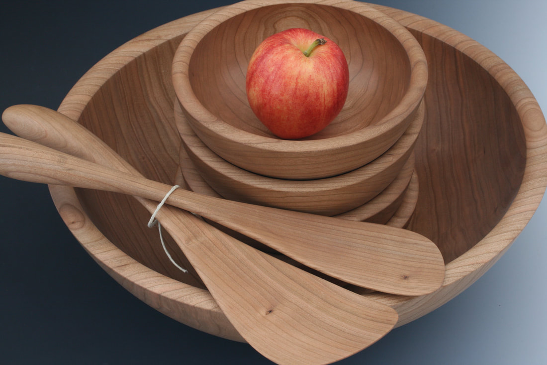 Solid cherry wood salad serice set for 4 including salad serving paddles.